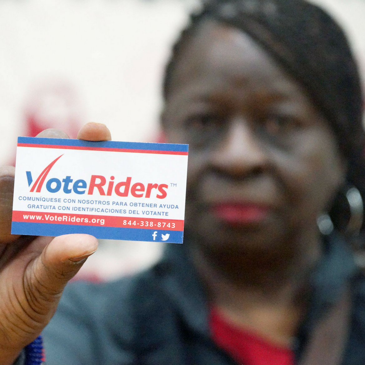 Anita holding VoteRiders card